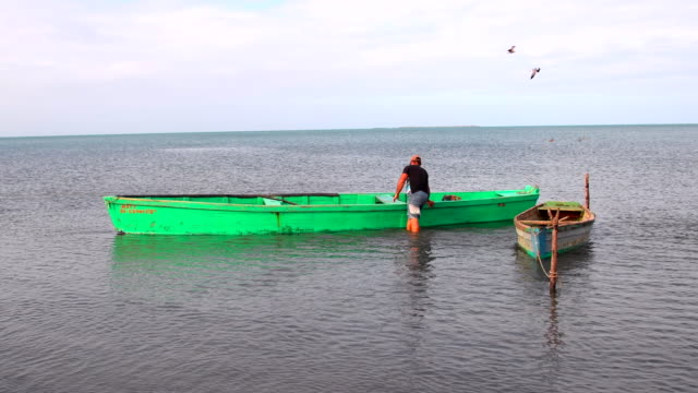 due to a government regulation boats cannot have a keel to avoid possible emigration but this makes the fishing work more dangerous as boats are more... - sancti spiritus province stock videos and b-roll footage
