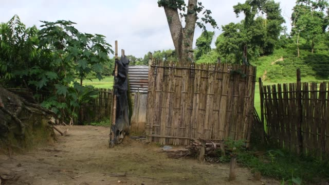 vídeos de stock, filmes e b-roll de due to lack of proper sanitation facilities, tea workers in sylhet are being compelled to use diy made toilets - dependência
