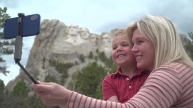 due to the coronavirus pandemic crowds have dwindled at the mount rushmore national memorial famed for its sculpted heads of former us presidents - mt rushmore national monument stock videos & royalty-free footage
