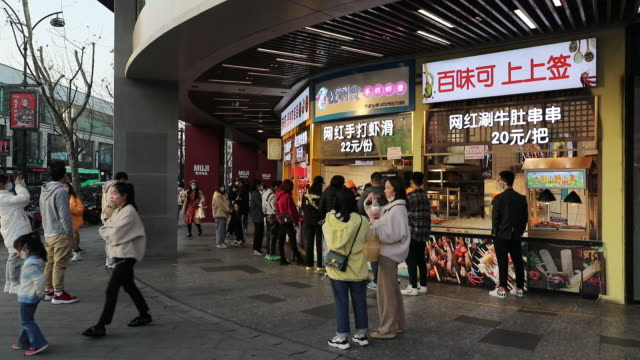 due to the severe epidemic people in zhejiang wearing masks are snapping up necessities and food in the supermarket almost all the food in the... - zhejiang province stock videos & royalty-free footage