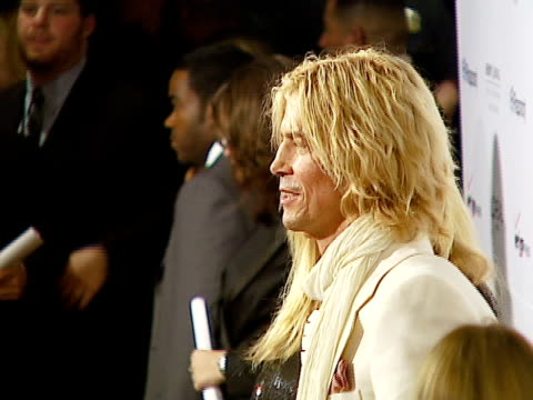 duff mckagan, velvet revolver, susan holmes at the legendary clive davis pre-grammy party at beverly hills california. - ベルベット点の映像素材/bロール