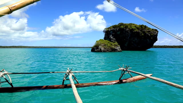dugout canoe ride on isle of pines, new caledonia - south pacific ocean stock videos & royalty-free footage