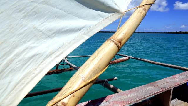 dugout canoe ride on isle of pines, new caledonia - polynesian culture stock videos and b-roll footage
