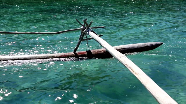 dugout canoe ride on isle of pines, new caledonia - dugout stock videos & royalty-free footage