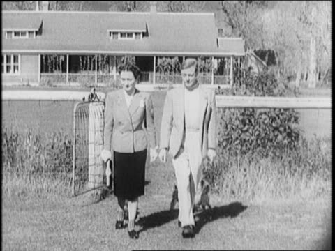 duke and duchess exit train / cars drive through town people watch / edward and wallis step out of ranch house with dogs stand on lawn / indian... - wallis simpson stock videos & royalty-free footage
