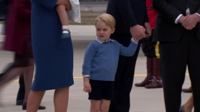 Duke and Duchess of Cambridge arrival Royal family along on runway as Prince George waves / Duchess holding Princess Charlotte