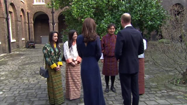 Duke and Duchess of Cambridge at reception EXT Prince William Duke of Cambridge and Catherine Duchess of Cambridge along into courtyard and meeting...