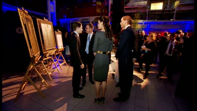 stockvideo's en b-roll-footage met duke and duchess of cambridge at the imperial war museum planes on display / lord rothermere with kate and wiliam / various shots of artefacts on... - imperial war museum museum