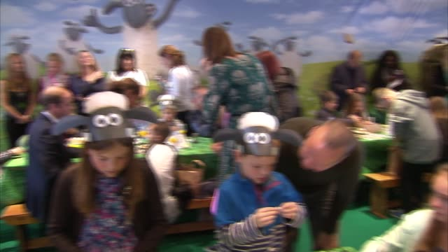 duke and duchess of cambridge attend bafta charity event kate sitting at table making things with plastercine and chatting with children / prince... - wohltätigkeit stock-videos und b-roll-filmmaterial