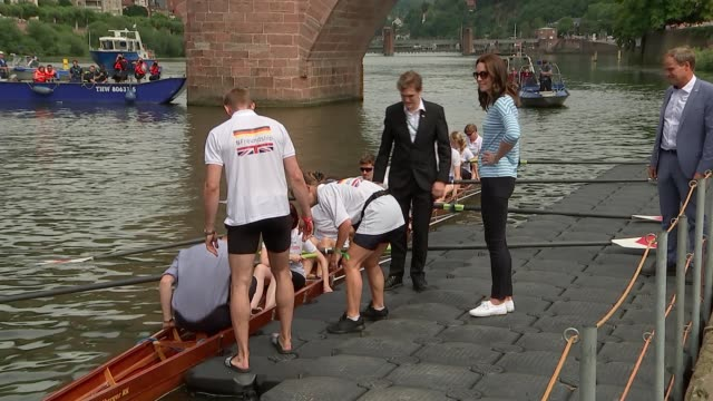Duke and Duchess of Cambridge attend food fair / rowing boat race EXT Prince William and Catherine greet crowd by river / greet rowers / get on...