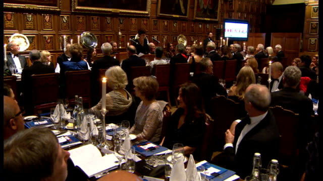 duke and duchess of cambridge attend reception and dinner in aid of university of st andrews 600th anniversary appeal william and catherine sitting... - card table stock videos & royalty-free footage