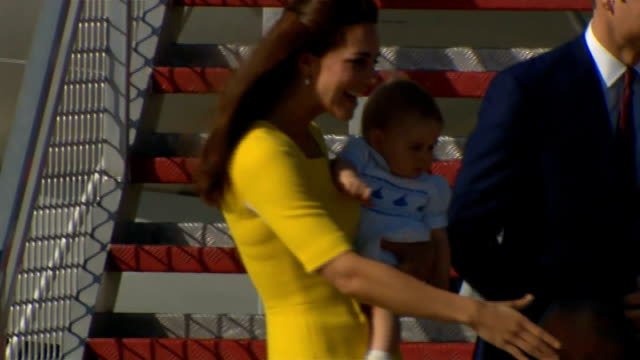 duke and duchess of cambridge begin visit australia sydney ext prince william the duke of cambridge and catherine duchess of cambridge who is holding... - bennelong point stock videos and b-roll footage