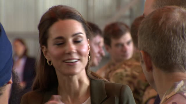Duke and Duchess of Cambridge chatting and laughing with military personnel on their visit to RAF Akrotiri in Cyprus