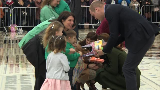 duke and duchess of cambridge chatting with children during visit to blackpool - blackpool stock-videos und b-roll-filmmaterial
