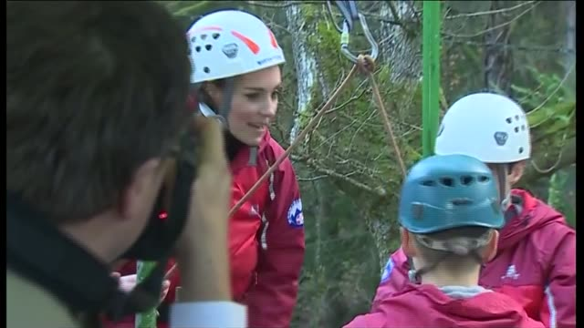 duke and duchess of cambridge in snowdonia duchess of cambridge with abseiling instructors then back towards building / duke and duchess of cambridge... - snowdonia video stock e b–roll