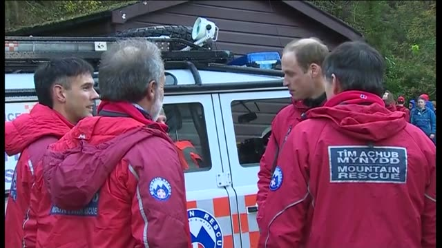 duke and duchess of cambridge in snowdonia duke and duchess of cambridge pose for photo with mountain rescue team / duke of cambridge chats with crew... - mountain pose stock videos and b-roll footage