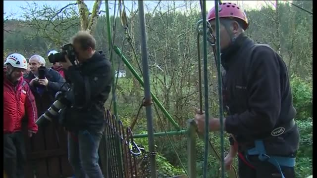 duke and duchess of cambridge in snowdonia ext duke and duchess of cambridge wearing helmets / through gate with others all wearing raincoats and... - abseiling stock videos & royalty-free footage