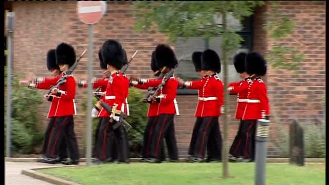 Duke and Duchess of Cambridge present medals to 1st Battalion Irish Guards arrival Close shot of plaque on Irish Guardsmen war memorial/ Irish Guards...