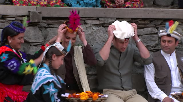 duke and duchess of cambridge put on traditional headwear during visit to kalash village during their tour of pakistan - headwear stock videos & royalty-free footage