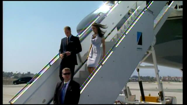 day one in California via REUTERS USA California Los Angeles EXT Prince William and Catherine disembarking aircraft at airport and being greeted by...