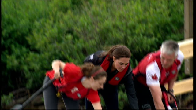 duke and duchess of cambridge royal tour of canada: day 5: dalvay lake; catherine watching / kate helps get dragon boat in water / kate climbs into... - day 5 stock videos & royalty-free footage