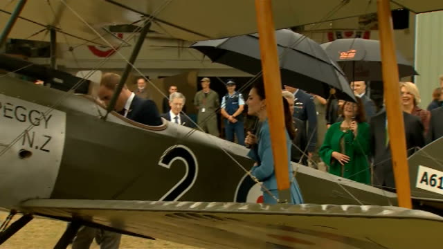 Duke and Duchess of Cambridge Royal visit Duke and Duchess of Cambridge along beneath umbrella on tour of World War One planes at aircraft museum...