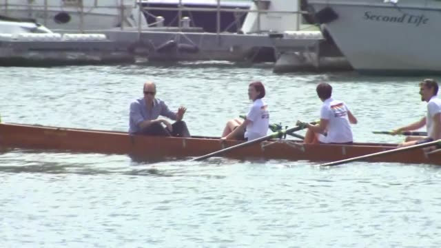 duke and duchess of cambridge take part in boat race: finish; germany: heidelberg: ext rowing boats along in 'friendship race' / crowds gathered on... - ハイデルベルク点の映像素材/bロール