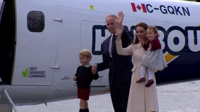 duke and duchess of cambridge tour ends princess charlotte waving as holding her mother's hand press photographers and crowds lining harbourside... - charlotte stock-videos und b-roll-filmmaterial