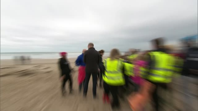 duke and duchess of cambridge visit beach in north wales; wales: porthaethwy: newborough beach: ext various of prince william, duke of cambridge,... - raw footage stock videos & royalty-free footage