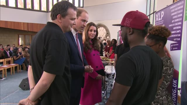 duke and duchess of cambridge visit charities in gipsy hill more of duke and duchess of cambridge meeting performers from xlp charity on stage / kate... - strampelanzug stock-videos und b-roll-filmmaterial