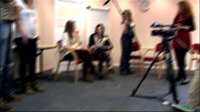 Duke and Duchess of Cambridge visit Child Bereavement UK interior shots GV staff filming sequence as William and Kate watch on / GV William and Kate...