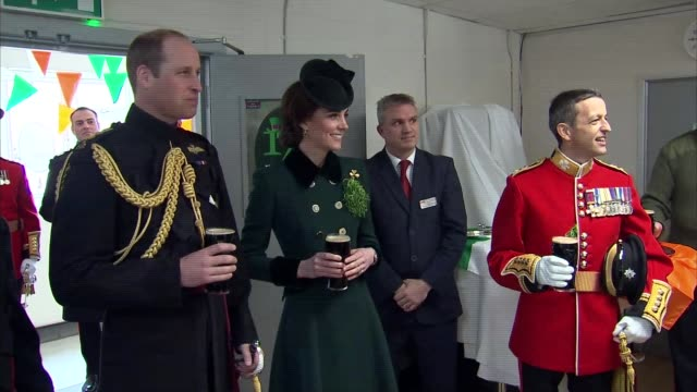 duke and duchess of cambridge visit irish guards to mark st patrick's day prince william and catherine duchess of cambridge holding pint of guinness... - royalty stock videos & royalty-free footage
