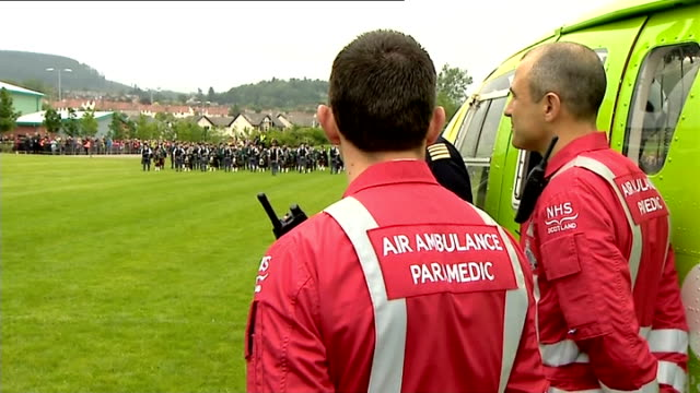 duke and duchess of cambridge visit scotland crieff william along shaking hands and chatting / air ambulance crew / paramedics waiting / close shot... - uniform stock videos & royalty-free footage