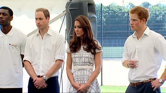 duke and duchess of cambridge visit sports coaching project england london rotherhithe bacon's college int close up shot of kate's face / prince... - ärmel stock-videos und b-roll-filmmaterial