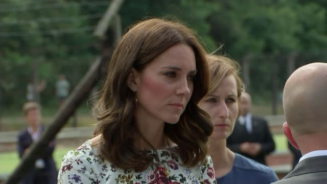 duke and duchess of cambridge visit stutthof concentration camp stutthof concentration camp ext close shot of duchess of cambridge standing talking... - konzentrationslager stock-videos und b-roll-filmmaterial