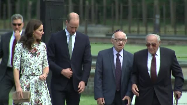 Duke and Duchess of Cambridge visit Stutthof Concentration Camp POLAND Former Stutthof Concentration Camp EXT Small Union Jack and Polish flags on...