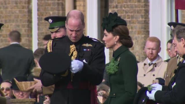 duke and duchess of cambridge visit the 1st battalion irish guards at the st patrick's day parade kate hands out shamrocks england london hounslow... - 受ける点の映像素材/bロール