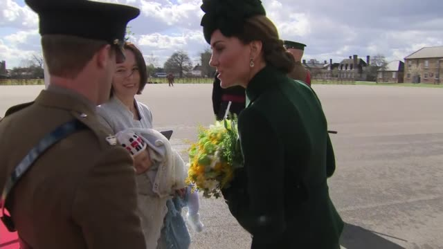 duke and duchess of cambridge visit the 1st battalion irish guards at the st. patrick's day parade: kate hands out shamrocks; england: london:... - st. patrick's day stock videos & royalty-free footage
