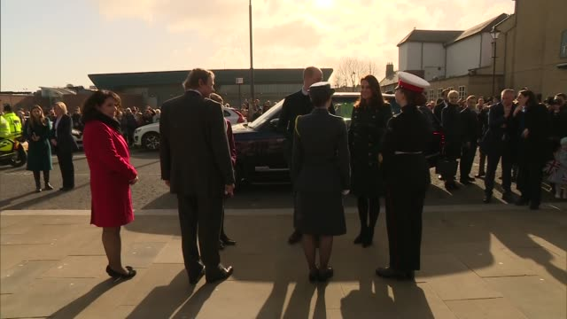 Duke and Duchess of Cambridge visit The Fire Station arts venue ENGLAND Tyne and Wear Sunderland EXT Crowd with Union Jack flags waiting to greet...