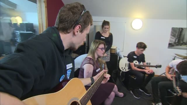 duke and duchess of cambridge visit zebs youth centre in truro young people playing musical instruments in studio sot / william and kate listening to... - cornwall england stock videos and b-roll footage