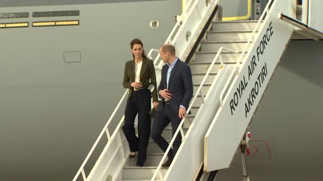 Duke and Duchess of Cambridge walking down steps of military aircraft on their visit to RAF Akrotiri Cyprus
