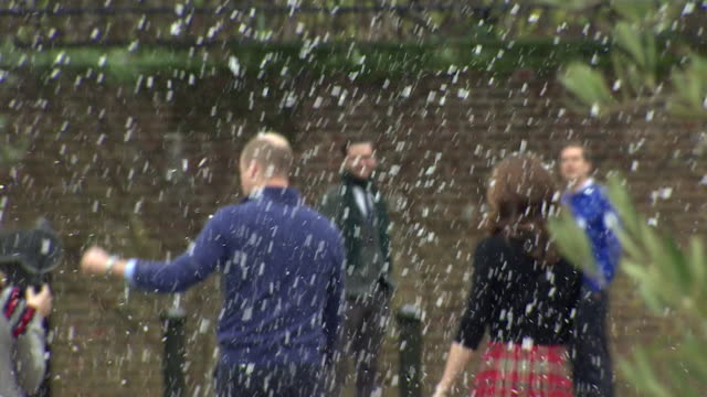duke and duchess of cambridge walking through fake snow as they leave the christmas party for deployed military personnel at kensington palace - fake snow stock videos & royalty-free footage