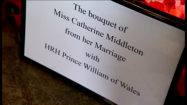 duke and duchess of cambridge wedding: day after: events; westminster abbey: close shot of catherine's wedding bouquet on tomb of unknown the soldier... - tomb of the unknown warrior westminster abbey stock videos & royalty-free footage