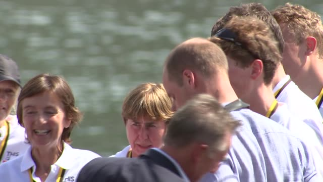 duke and duchess of camridge race boats in heidelberg; prince william and catherine awarded medals / opening beer keg with mallet / drinking beer /... - ハイデルベルク点の映像素材/bロール