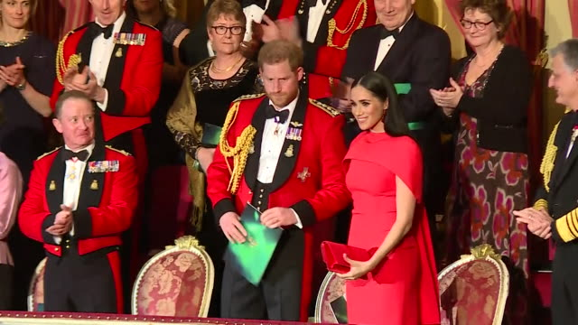 duke and duchess of sussex arrive on the balcony at the royal albert hall to applause for the mountbatten festival of music - royal albert hall点の映像素材/bロール