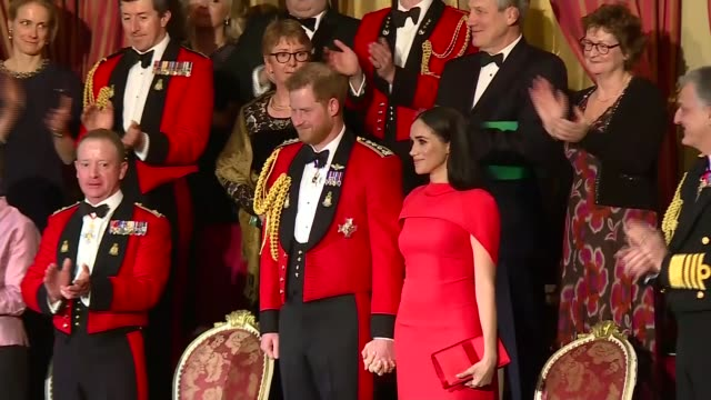 duke and duchess of sussex attend mountbatten festival of music; england: london: royal albert hall: prince harry, duke of sussex and meghan, duchess... - royal albert hall点の映像素材/bロール