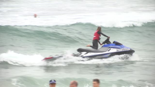 duke and duchess of sussex australia tour bondi beach visit australia sydney bondi beach ext 'sparkle like markle' placards / people surfing / man on... - harry meghan tour stock videos and b-roll footage