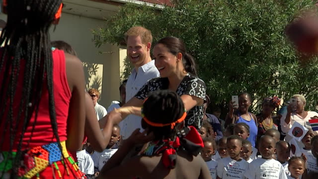 duke and duchess of sussex dance during their visit to nyanga township in cape town as part of their africa tour - harry meghan tour stock videos and b-roll footage
