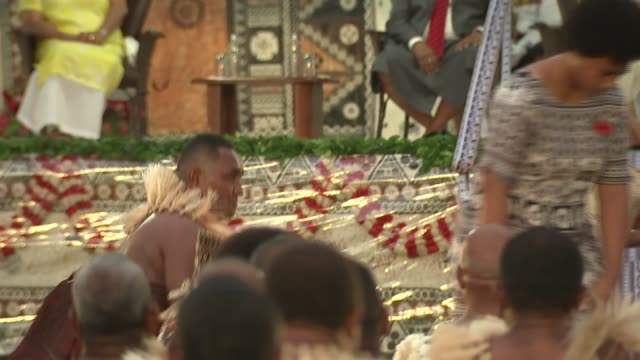 Albert Park welcome ceremony FIJI Suva Albert Park Women along putting rugs by stage / Prince Harry Duke of Sussex and Meghan Duchess of Sussex...