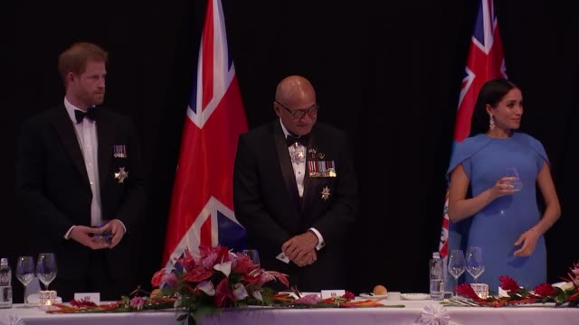 reception and banquet FIJI Suva Prince Harry Duke of Sussex returns to sit with Jioji Konrote Meghan Duchess of Sussex and Sarote Faga Konrote for...